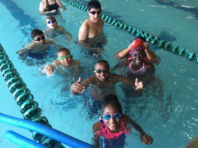 photo of children swimming