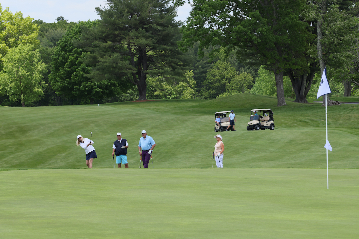 golfers playing in the reliant Foundation Drive for a Difference